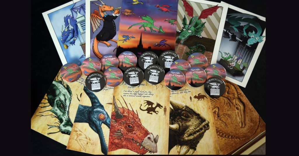 Dragon postcards and badges.